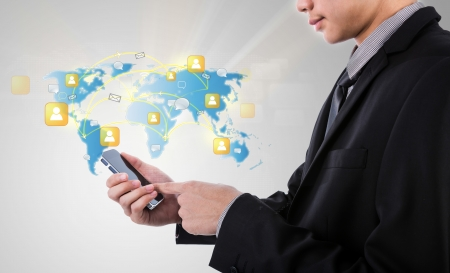 Business man holding Modern communication technology mobile phone show the social network photo