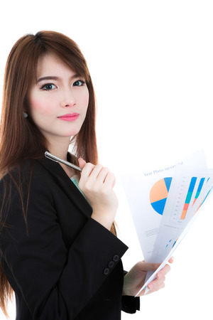Business woman hold clipboard paper with finance chart isolated over white background photo