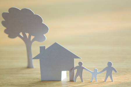 Paper cut of family with house and tree photo