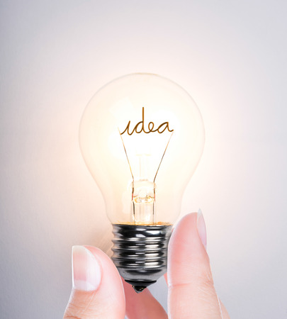 Hand with light bulb Stock Photo - 26890369