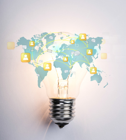 Light Bulb with world map of social network photo