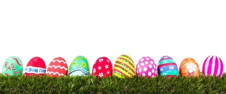 Easter Eggs on Fresh Green Grass over white background photo