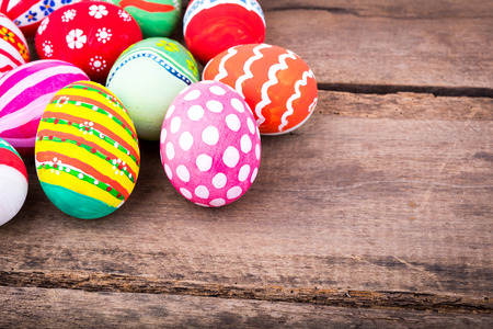 Easter eggs on wooden background photo