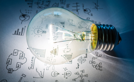 web design: Light bulb with drawing graph