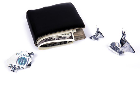 Business concept : Dollar currency origami  rabbit and  turtle with old black wallet on the white background photo
