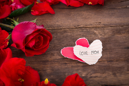 Two Heart shaped paper  on wood with decoration of red rose - valentine  background photo
