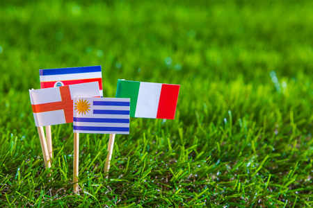 Paper cut of flags on grass for Soccer championship 2014 , group D photo