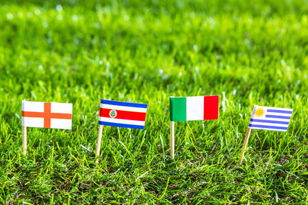 costa rican flag: Paper cut of flags on grass for Soccer championship 2014 , group D Stock Photo
