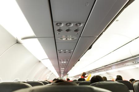 No Smoking and Fasten Seat belt Sign on Airplane photo