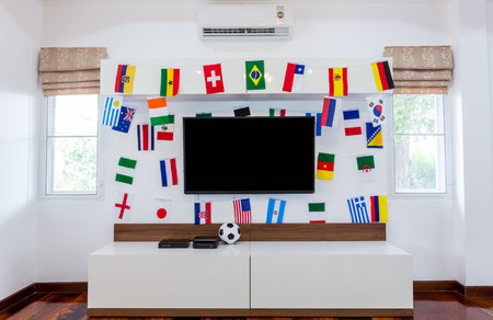 Modern room with TV and Flags for soccer championship 2014 photo