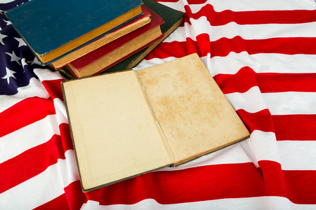 Vintage open book on American flag photo