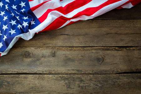 american states: American flag on wood background