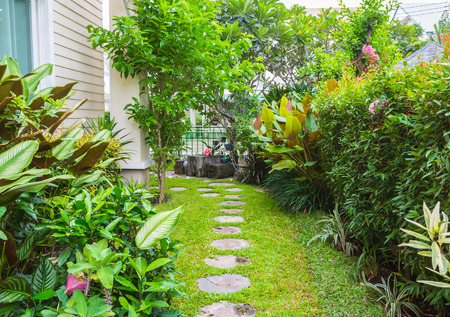 Flagstone path in home garden Stock Photo