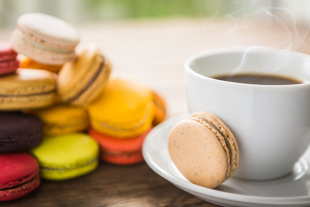 French colorful macarons with cup of coffee Stock Photo