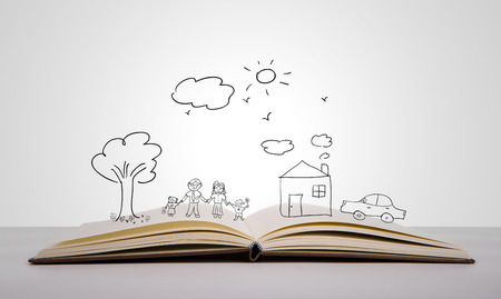Hand draw in open book of lovely family photo