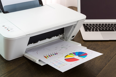 typer: printer and Laptop on wood table Stock Photo