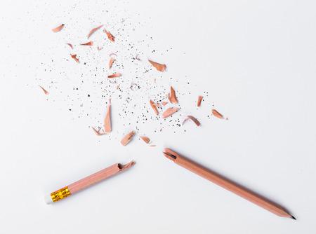 Broken Pencil on white paper Stock Photo