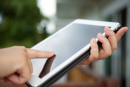 Hand hold white tablet photo