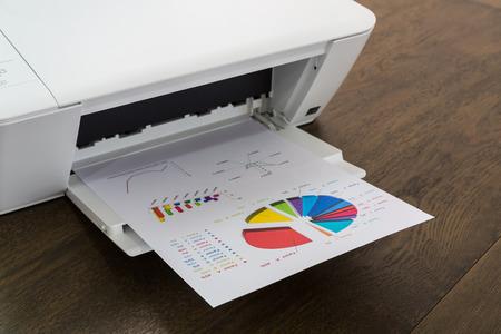 printer on wood table photo