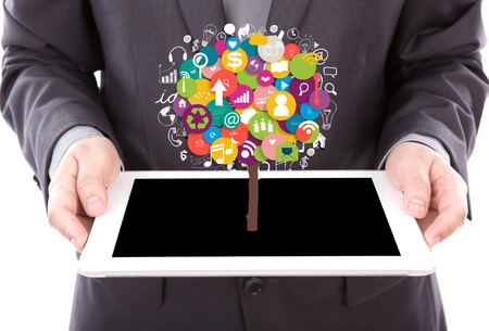 Portrait of young business man using a touch screen device with tree of application photo