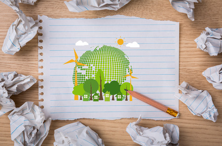 Eco friendly earth White note book paper with  pencil and crumpled paper photo