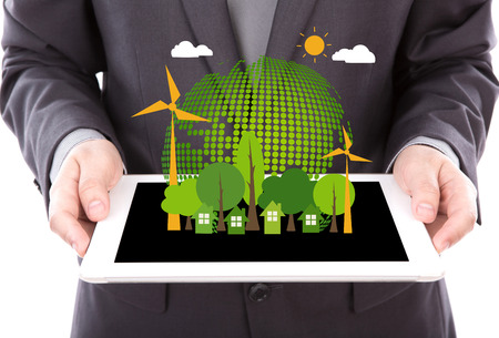 Portrait of young business man using a touch screen device with Eco friendly earth photo