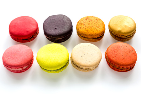 maroni: French colorful macarons on white background