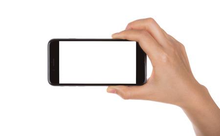 空白の画面分離された白い背景を持つモバイルのスマート フォンを持っている手
