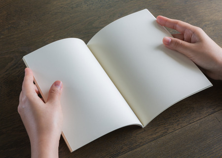 open space: Hands open book on wood table Stock Photo