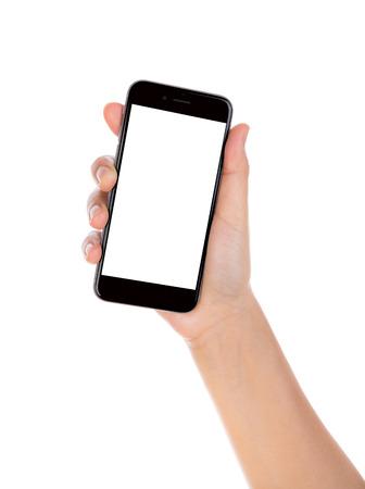 画面が空白に分離した白い背景を持つモバイル スマート フォンを持っている手