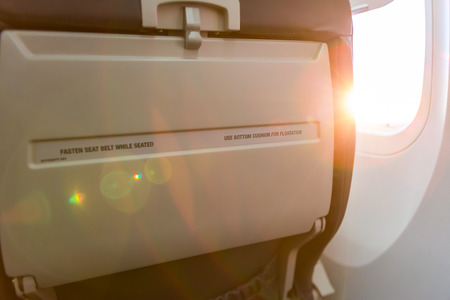seated: Seated sign on airplane fasten seat belt