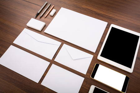 consist: Blank Template. Consist of Business cards, letterhead a4, Tablet PC, eraser ,pen,pencil,envelop es and smart phones Stock Photo