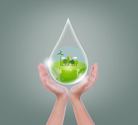 Woman hands hold water drop of eco friendly earth Standard-Bild
