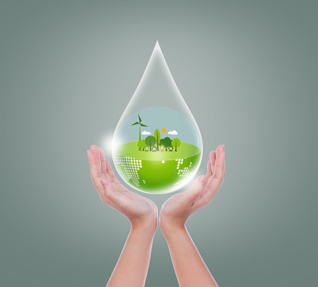 Woman hands hold water drop of eco friendly earth Stock Photo