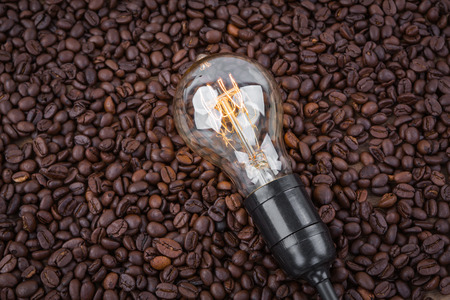 Light bulb on  coffee beans photo