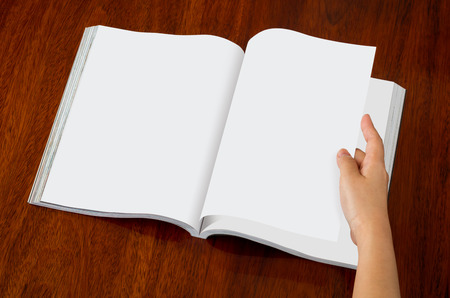page down: Blank catalog, magazines,book mock up on wood background ( with 4 layer clipping path : Hand,Left page,Right page up,Right page down)