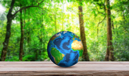 bio energy: Earth on wood table  (Elements of this image furnished by NASA)