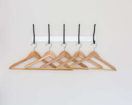Wood coat hanger on wall photo