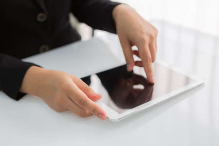 blank tablet: Woman hand touch white tablet with blank empty screen