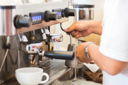 coffeeshop: Prepares espresso in coffee shop Stock Photo
