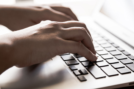 internet keyboard: Closeup of business woman hand typing on laptop keyboard