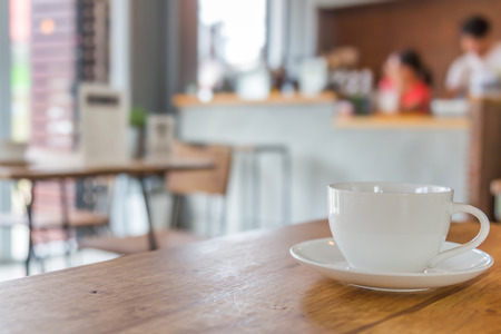 classic living room: Coffee cup on table in cafe Stock Photo