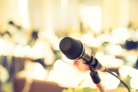 lecturing hall: Black microphone in   conference room ( Filtered image processed vintage effect. )
