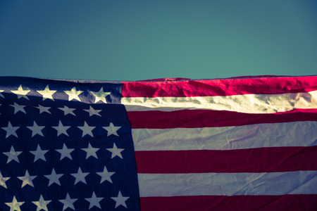 processed: American flag over blue sky ( Filtered image processed vintage effect. )