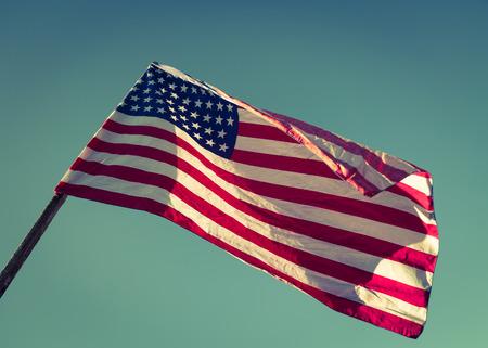 processed: American flag over blue sky ( Filtered image processed vintage effect. )