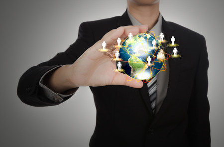 small world: Business man holding the small world in his hands against white background (Elements of this image furnished by NASA) Stock Photo
