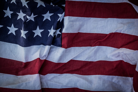 advertise with us: American flag on wood background ( Filtered image processed vintage effect. ) Stock Photo