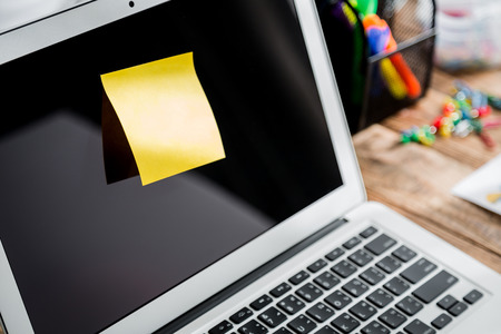 yellow paper: Note on laptop screen