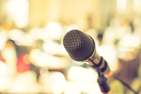 microphone: Black microphone in   conference room ( Filtered image processed vintage effect. )