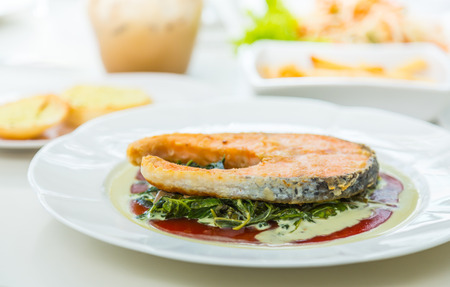 salmon steak: Grilled Salmon Steak with Spinach Stock Photo